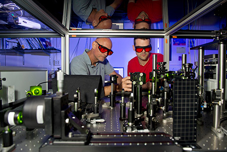 Professor Hartland and graduate student Todd Major work on an ultrafast laser experiment